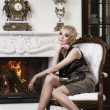 Beautiful blond woman in a luxury interior — Stock Photo