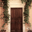 Wooden door of an ancient house - Stock Photo