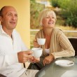 Stock Photo: Middle-aged couple drinking caffee