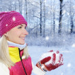 Frozen beautiful woman in winter clothing outdoors - Stock Photo