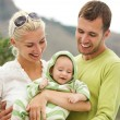 Happy family outdoors — Stock Photo #6228824
