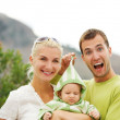 Happy family outdoors — Stockfoto #6228825