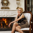 Blond lady near fireplace in a luxury interior — Foto Stock