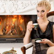 Blond lady drinking coffee in luxury interior — Stock Photo #6229025
