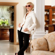 Stylish woman in luxury interior - Stock Photo