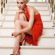 Attractive blond woman sitting on the stairs — Stock Photo