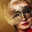Close-up portrait of a beautiful woman in carnival mask — Stock Photo #6229174