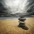 Stone tower on the beach — Stock Photo