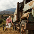 Attractive blond woman near the old car — Stock Photo #6229514