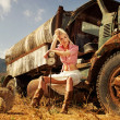 Attractive blond woman near the old car — Stock Photo