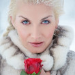 Attractive blond woman with a red rose — Stock Photo #6229526
