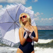 Attractive blond woman in the sea - Stok fotoğraf