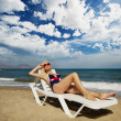 Blond woman relaxing near the sea — Stock Photo