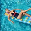 Pin up girl in the swimming pool - Stock Photo