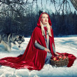 Royalty-Free Stock Photo: Red hood and a wolf behind her