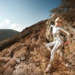 Cyber woman in the mountains — Stock Photo