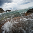 Big ocean wave breaking the rocks — Stock Photo
