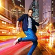 Stylish young dancer in the night city — Stock Photo