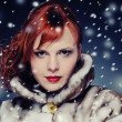 Redhead woman with fur coat - Stock Photo