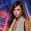 Stock Photo: Attractive brunette woman against night city