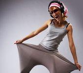 Stylish dancing young girl — Stock Photo