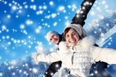 Happy smiling couple on a winter background — Stock Photo