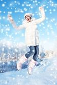 Happy girl jumping in the snow — Foto de Stock