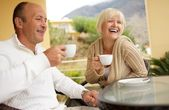 Middle-aged couple drinking caffee — Stock Photo