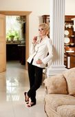 Stylish woman in luxury interior — Stock Photo