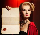 Attractive lady with an ancinet document — Stock Photo
