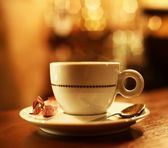 Coffee cup on abstract background — Stock Photo