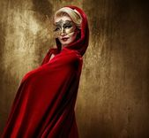 Beautiful lady in carnival mask — Stock Photo