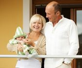 Grandparents with his grandchild — Stock Photo