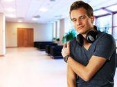 Handsome men with headphones indoors — Stock Photo