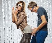 Young stylish couple flirting in the nightclub — Stock Photo
