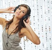 Stylish young girl with headphones — Stock Photo