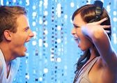 Attractive couple screaming in the nightclub — Stock Photo