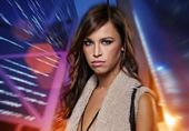 Attractive brunette woman against night city — Stock Photo