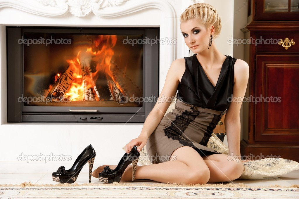 Blond lady near fireplace  Stock Photo #6229033