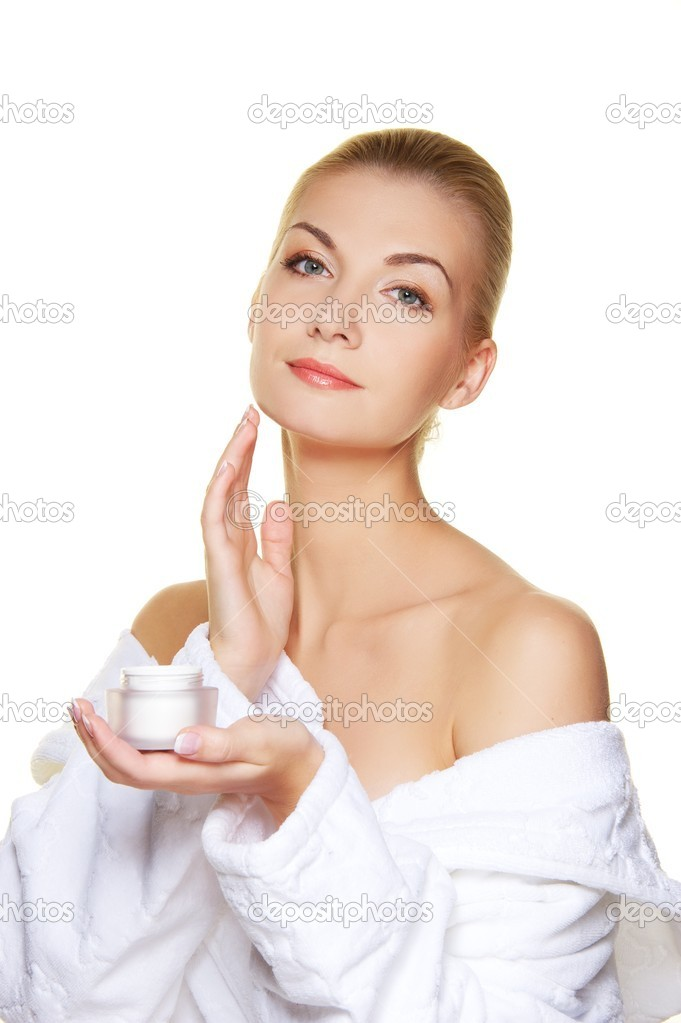 Woman applying moisturizer cream on her face — Stock Photo #6229245