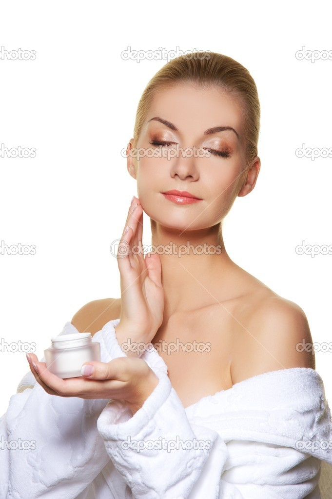 Woman applying moisturizer cream on ner face  Stock Photo #6229248