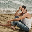 Handsome man relaxing on the beach — Stock Photo #6254922
