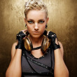 Stock Photo: Portrait of an attractive steam punk girl with headphones