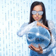Stylish brunette with a disco ball — Stock Photo
