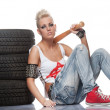 Punk girl with a bat sitting — Stockfoto