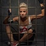 Punk girl behind bars — Stock Photo #6255169