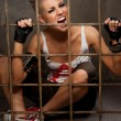 Punk girl behind bars — Stock Photo #6255170