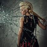 Punk girl with a bat behind broken glass — Stock Photo #6255206