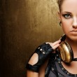 Portrait of an attractive steam punk girl with headphones — Stock Photo #6255345