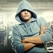 Young handsome man in a hood - Stock Photo